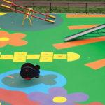 Покрытие для детских площадок от компании kindebum. Качественные материалы.